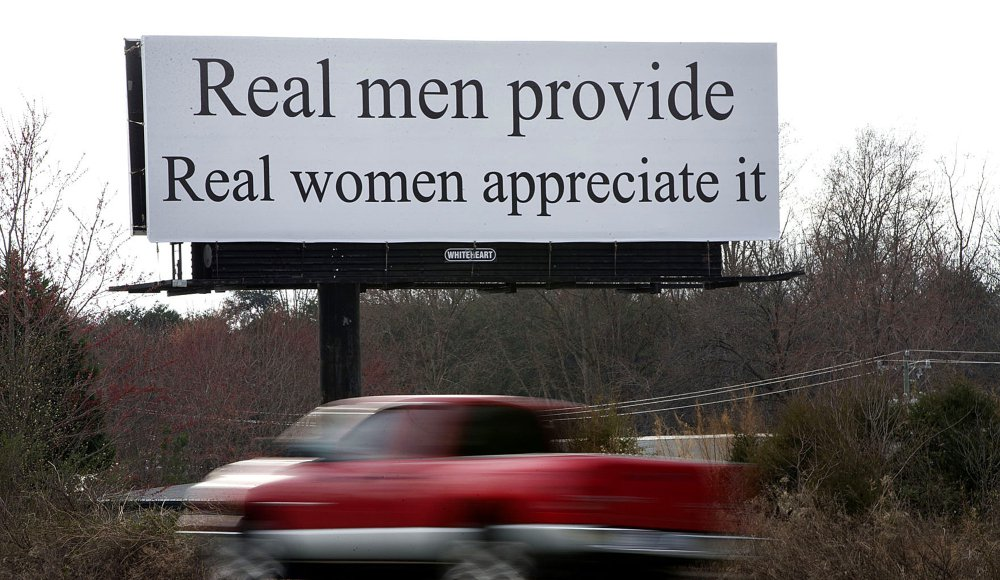 The billboard between Winston-Salem and Greensboro reads,