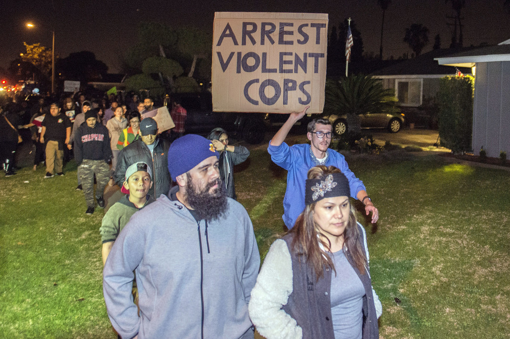 Hundreds of demonstrators march toward an off-duty police officer's home in Anaheim, Calif., late Wednesday.