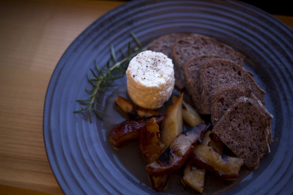 Basket-aged ricotta with grilled bosc pears, grilled bread and rosemary black pepper syrup.