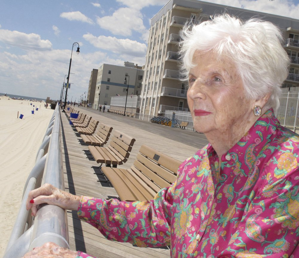 Lucille Conlin Horn stands on the boardwalk in Long Beach, N.Y., in July 2015. Born prematurely in 1920, she was not expected to survive before her parents entrusted her to a Coney Island doctor now seen as a pioneer in neonatology.