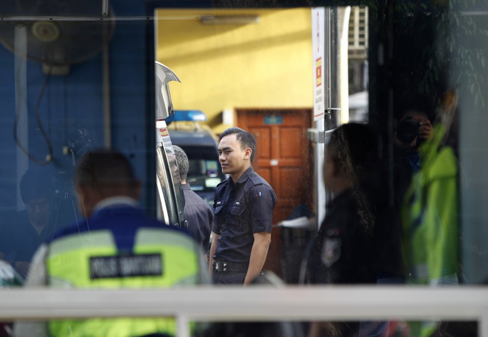 Police officers stay inside the guard post of the forensic department at Kuala Lumpur Hospital in Kuala Lumpur, Malaysia, on Saturday. According to police Friday, forensics stated that the banned chemical weapon VX nerve agent was used to kill Kim Jong Nam, the North Korean ruler's outcast half brother who was poisoned last week at the airport.