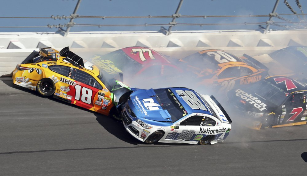 Dale Earnhardt Jr., 88, hits Kyle Busch, 18, along with Erik Jones, 77, Matt Kenseth, 20, and Elliott Sadler, 7, during the Daytona 500 Sunday at Daytona International Speedway in Daytona Beach, Fla.