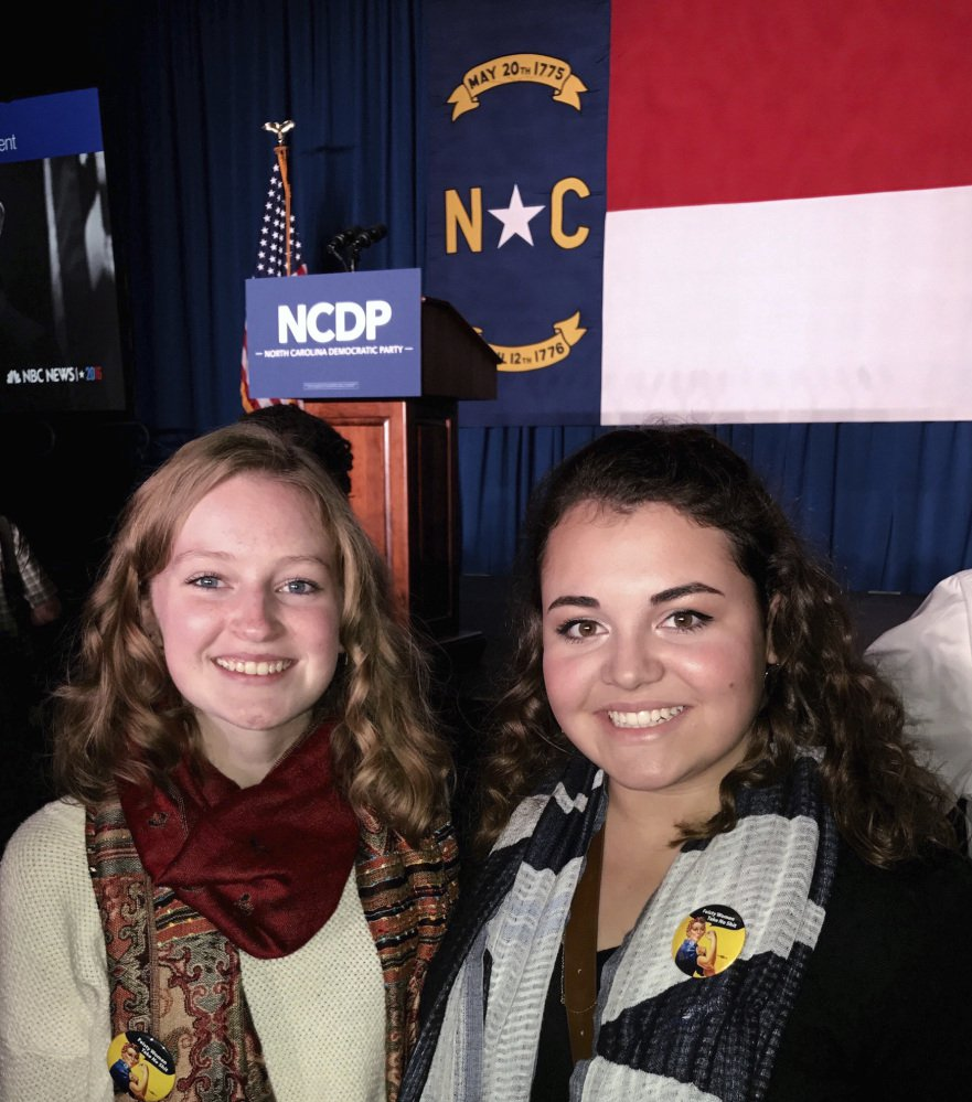 Caroline Millsaps, 16, left and her friend Kristin Barta attend a North Carolina Democratic Party event in 2016. Millsaps is one of 790 teenagers who took part in the Associated Press-NORC Center for Public Affairs poll.