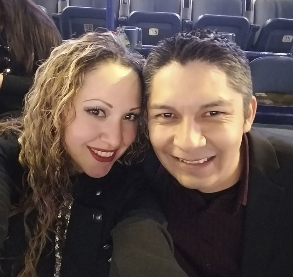 Elizabeth Hernandez, a U.S. citizen, poses with her husband, Juan Carlos Hernandez Pacheco, at a concert last year in Chicago.