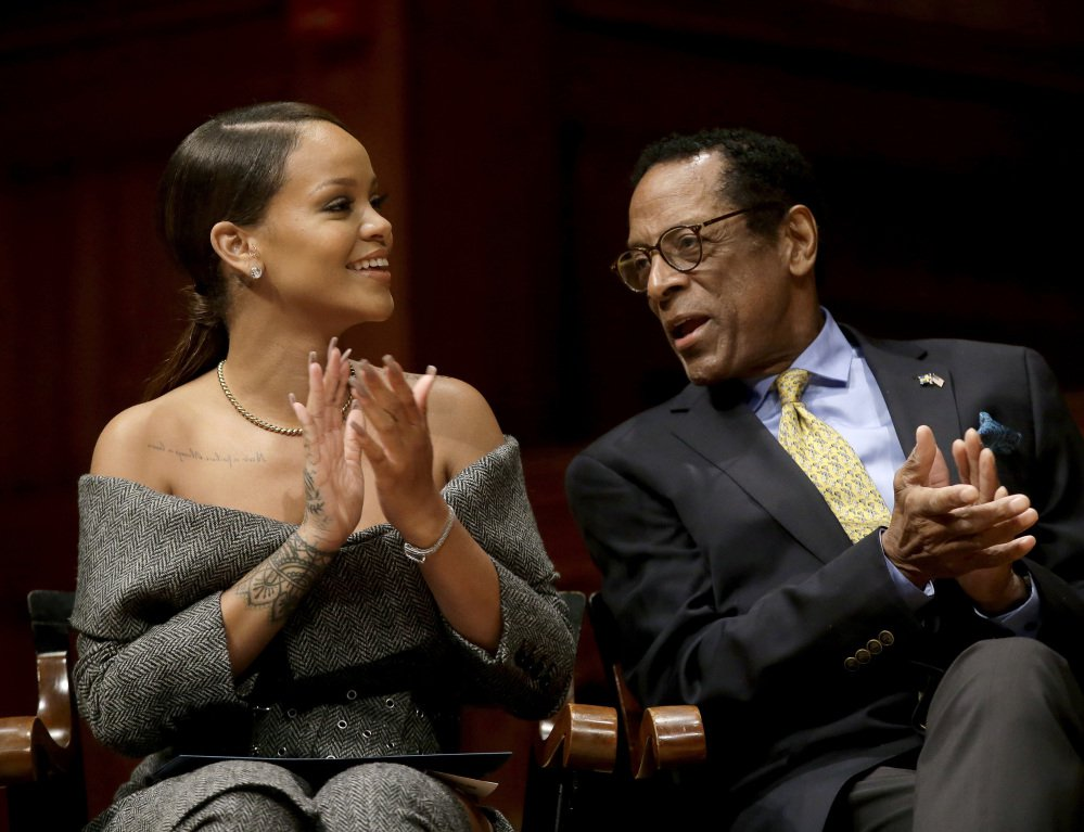 Singer Rihanna and Allen Counter, Harvard Foundation director, applaud during Harvard's Humanitarian of the Year Award ceremonies Tuesday in Cambridge, Mass.