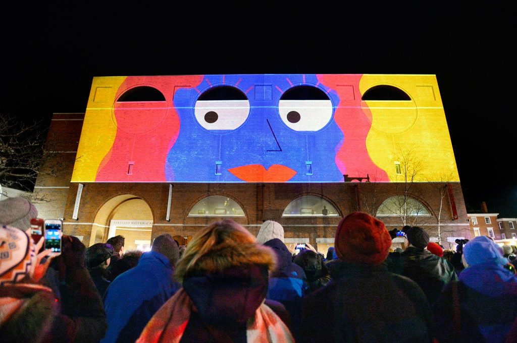 "The Portland Museum of Art reopened Friday after being closed for a month, and showed a large-scale animated 3D movie, ""Lights Across Congress,"" on the museum's facade facing Congress Street."