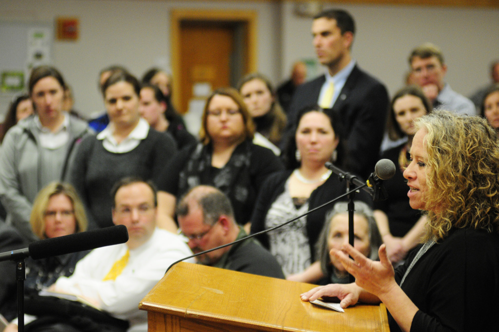 Manchester Elementary School teacher Jennie Galletta talks about health problems she's had that might have been connected to mold in the school during a Regional School Unit 38 School Board meeting last month at Maranacook Community School in Readfield.
