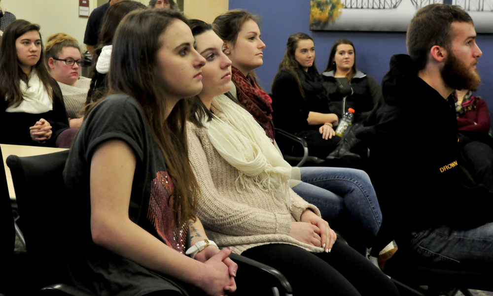 Thomas College students listen Thursday to artist Robert Shetterly, who spoke about promoting and recognizing people who make a positive contribution to society.
