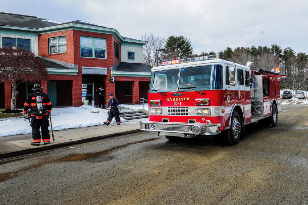 Gardiner firefighters leave River View Community School in Gardiner on Thursday afternoon after responding to a report of a small fire that the school staff had extinguished before they arrived.