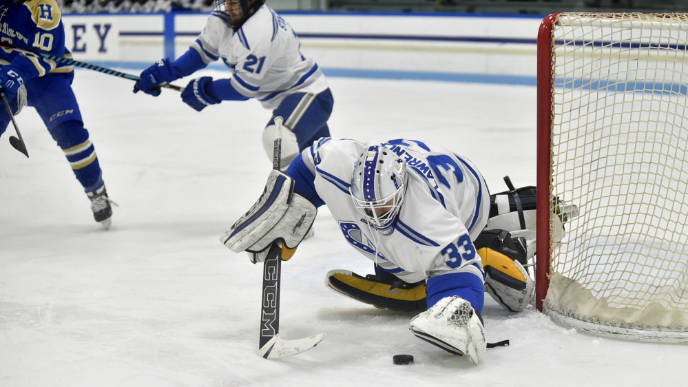 Colby goalie Sean Lawrence makes a save against Hamilton in the first period Friday night.