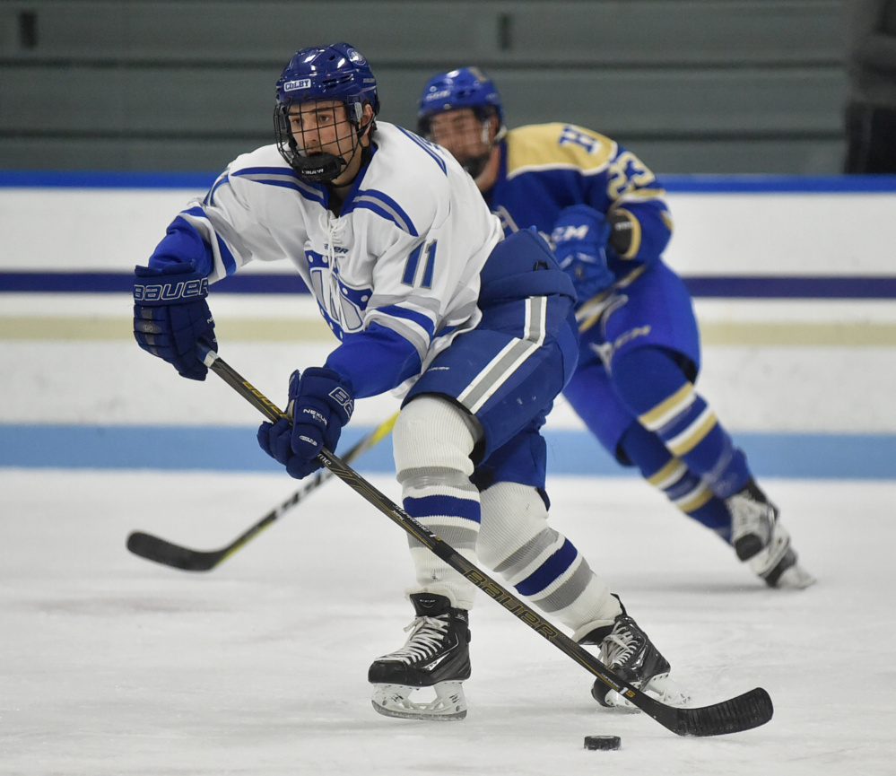 Colby's Kienan Scott skates down the ice in the first period Friday night against Hamilton College.