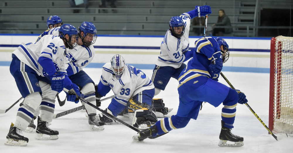 Colby goalie Sean Lawrence (33) makes a save against Hamilton in the first period Friday.