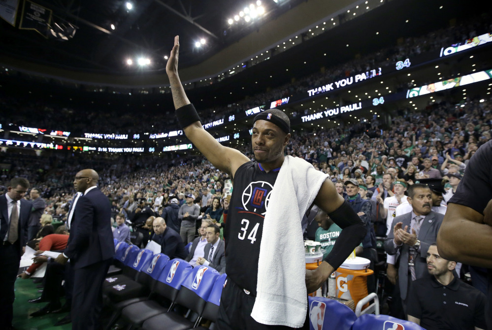 Los Angeles Clippers forward Paul Pierce, center, acknowledges applause from the crowd during a timeout in the first half against the Boston Celtics on Sunday in Boston. Pierce, a former Celtics player, played in what is expected to be his final game in Boston on Sunday.