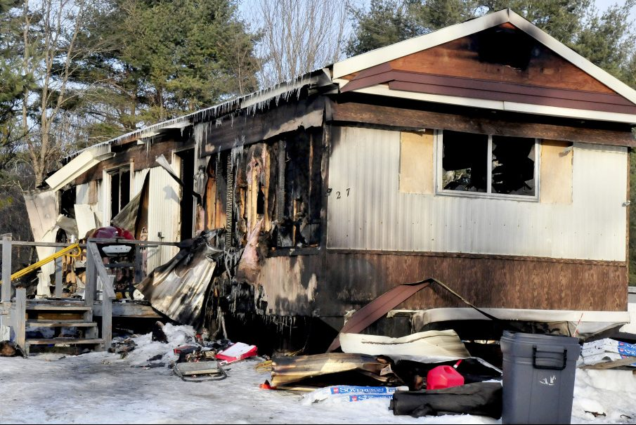 The remains of a mobile home and its contents litter the home site on the Browns Corner Road in Canaan on Sunday. The home was destroyed by fire on Saturday afternoon. Owner Laura Dudley escaped the home and a cat was report missing.