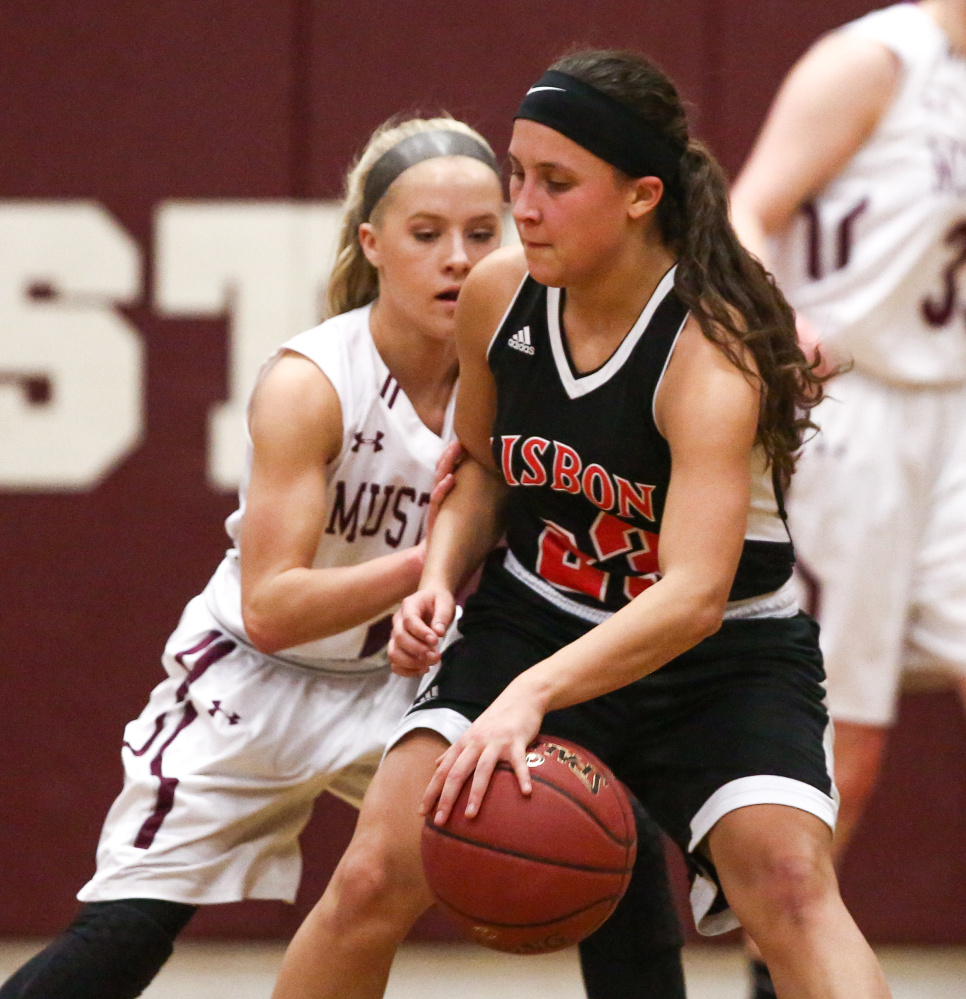Lisbon's Giana Russo tries to get past a Monmouth defender during the first half of a game Monday night in Monmouth.