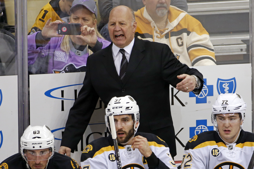 Boston Bruins head coach Claude Julien motions to an official during the first period of a Jan. 22 game against the Penguins in Pittsburgh.