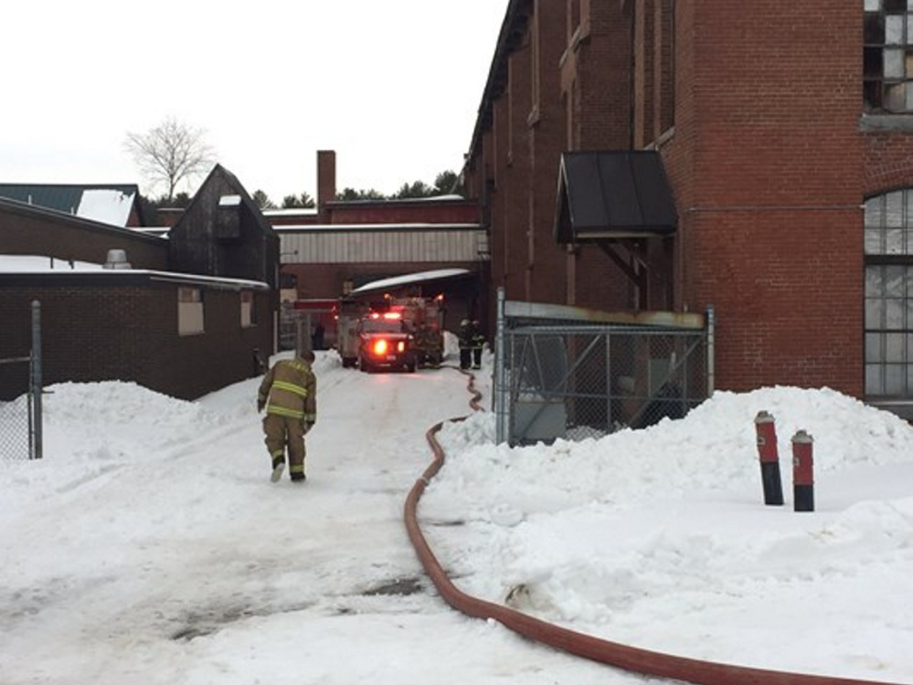 Firefighters respond to a fire Wednesday at the former San Antonio Shoe factory in Pittsfield.