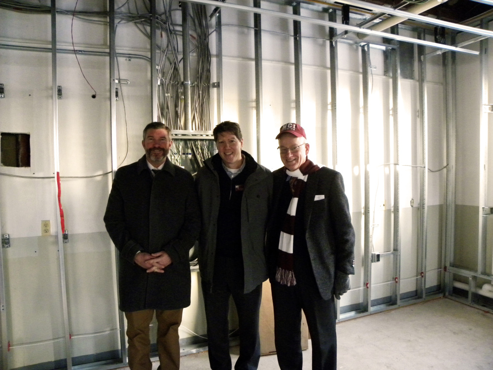 From left, Maine Central Institute Headmaster Chris Hopkins, Maine Central Institite board of trustees President Norbert W. Young Jr. and MCI trustee Timothy Archibald tour a renovation site Feb. 3 in JR Cianchette Hall with other members of the board of trustees.