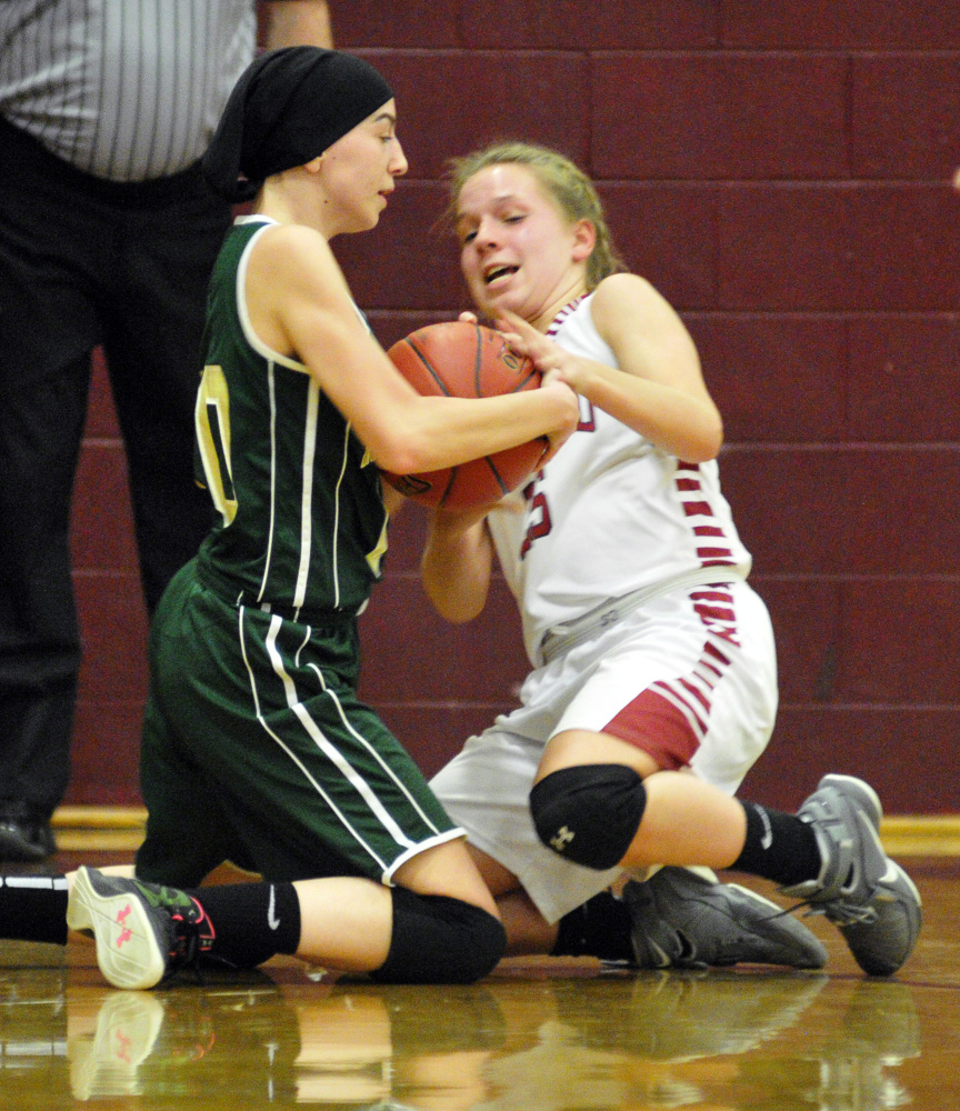 Rangeley's Brooke Egan, left, and Richmond's Caitlin Kendrick wrestle for the ball during a game in Richmond.