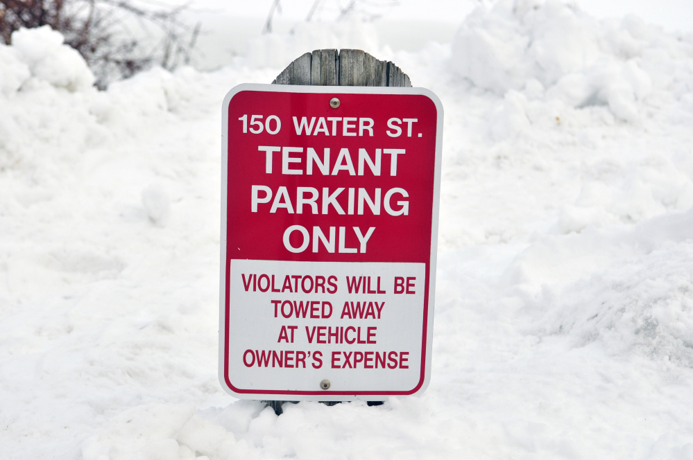 Tenants at 150 Water St. in downtown Hallowell have reserved parking spots, as seen Wednesday.