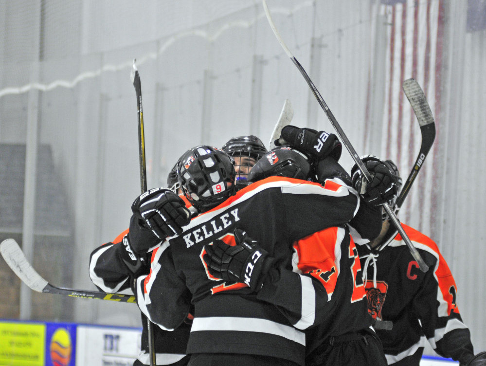 Members of the Gardiner hockey team celebrate a goal in second period of a game against rival Cony on Friday at the Camden National Bank Ice Vault in Hallowell.