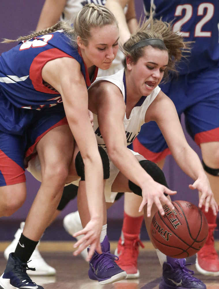 Waterville junior guard Mackenzie St. Pierre and Messalonskee junior guard Ally Turner fight for possession of the ball in the second half of a Kennebec Valley Athletic Conference Class A game Friday night.