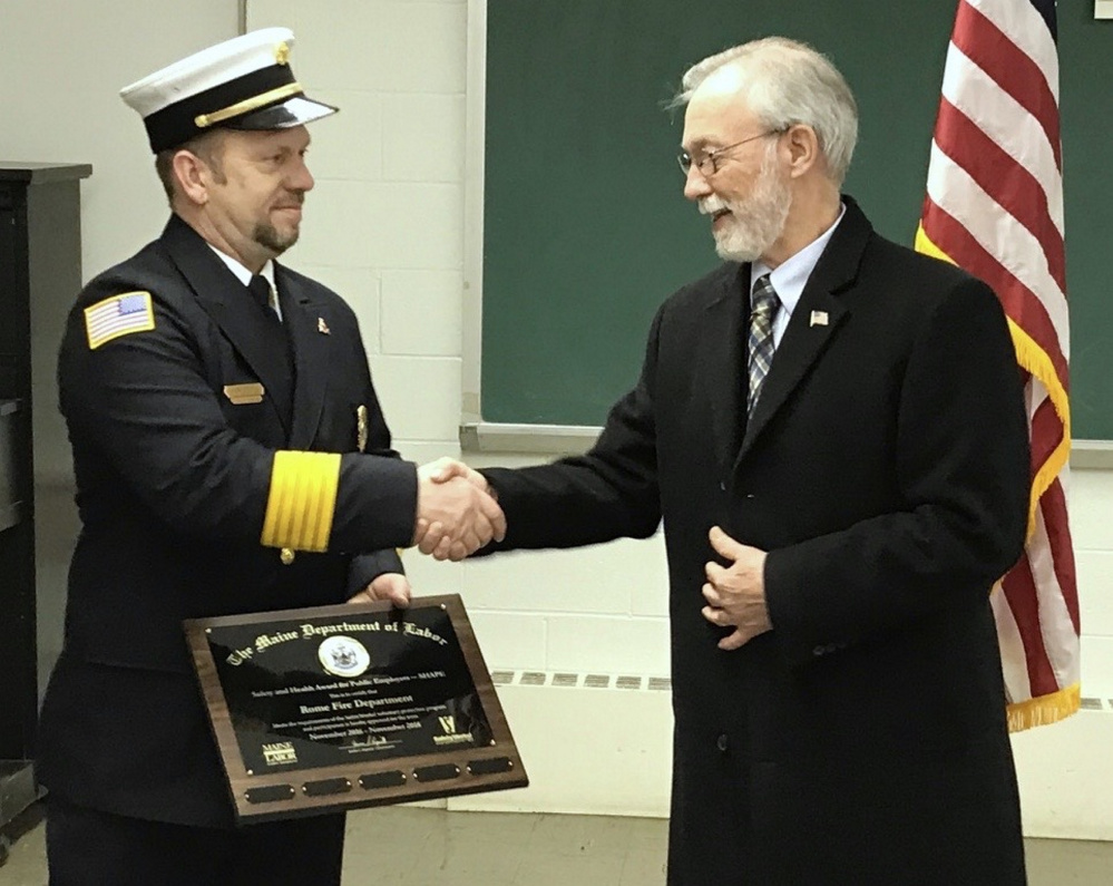 Representatives from the Department of Labor presented Gary Foss, chief of the Rome Fire Department, with the Safety and Health Award for Public Employers Jan. 23. From left are Gary Foss, Rome Fire Chief, and Sen. Rodney Whittemore, R-Skowhegan.