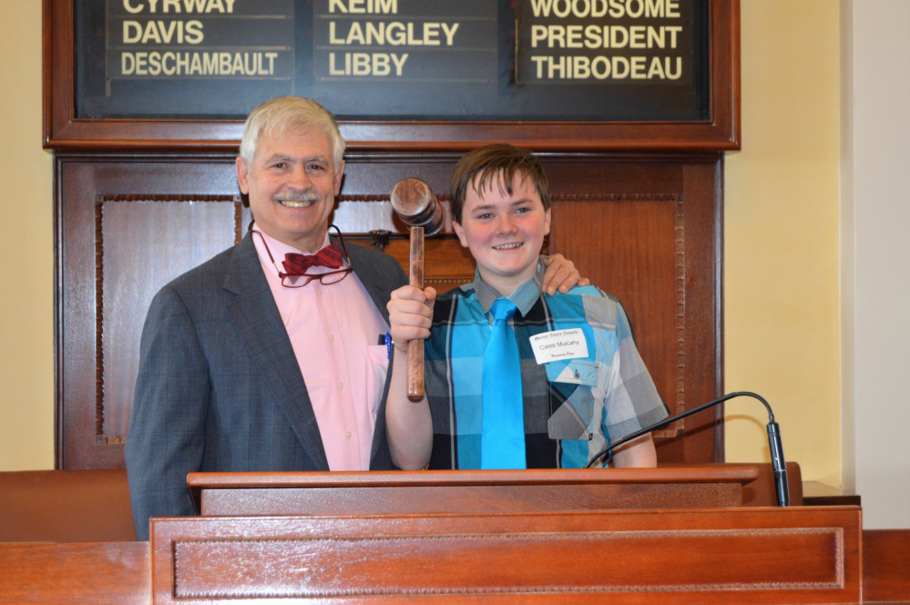Caleb Mulcahy, of New Sharon, a 4-H member, served as an Honorary Page Feb. 2 at the Maine State House. With Mulcahy is Sen. Tom Saviello, R-Wilton.