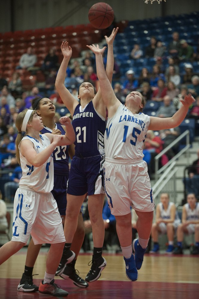 Lawrence's Morgan Boudreau and Hampden's Brooklyn Scott battle for a rebound during a Class A North quarte final game Friday at the Augusta Civic Center. Lawrence's Brooklyn Lambert and Hampden's Bailey Donovan look on at left.