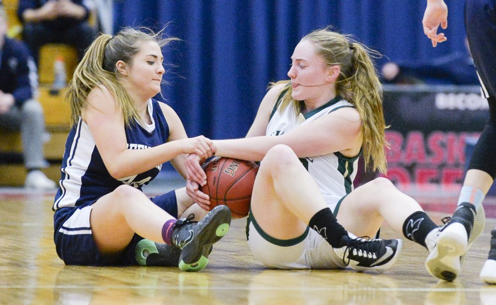 Greenville's Jordan Mann fights to get the ball from Temple's Daphne Labbe during the second half of a Class D South quarterfinal Saturday in Augusta. Temple topped the Lakers 42-40.