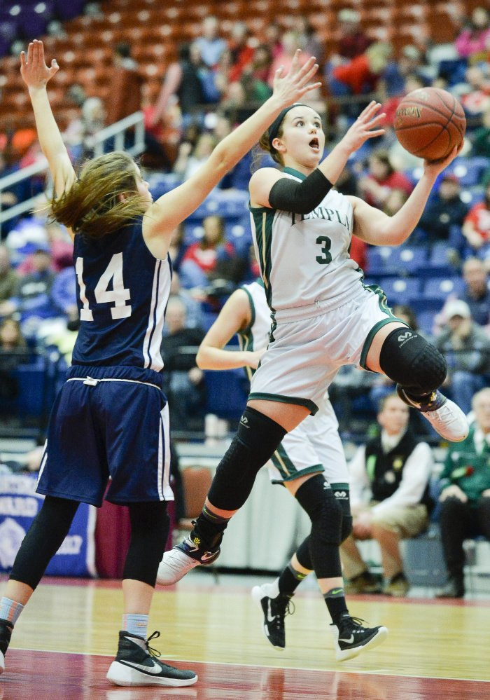 Veronica Rossignol soars to the basket to make a shot past Greenville  defender Morgan Noyes during a Class D South quarterfinal game Saturday morning at the Augusta Civic Center