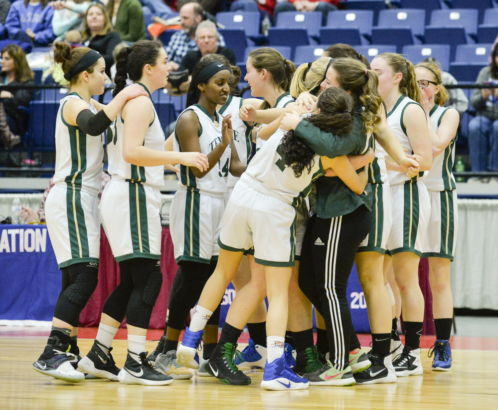 The Temple girls basketball team celebrates a hard-fought 42-40 victory over Greenville in a D South quarterfinal game Saturday morning at the Augusta Civic Center.