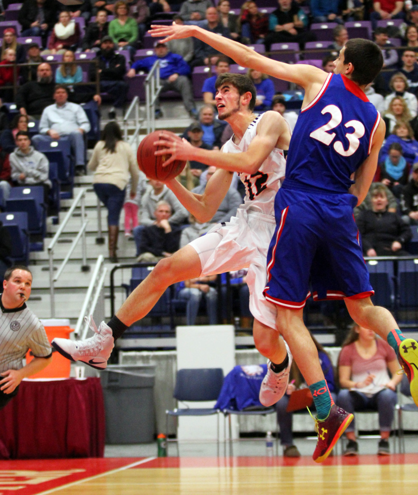 Gardiner Area High School's Connor McGuire gets fouled by Messalonskee High School's Griffin Tuttle on a drive to the basket in the first half of a Class A North quarterfinal in Augusta on Saturday night.
