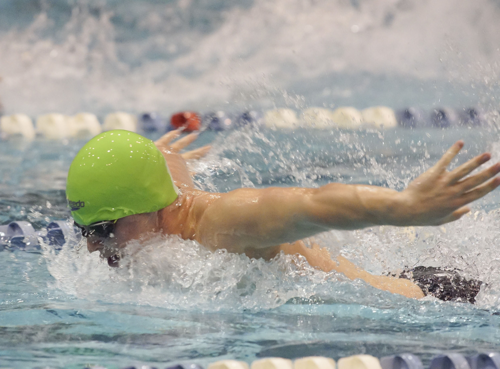 Old Town swimmer Noah Burr swims the butterfly leg of the 200 medley relay during the Class B state swimming and diving championships Saturday at Wallace Pool in Orono.