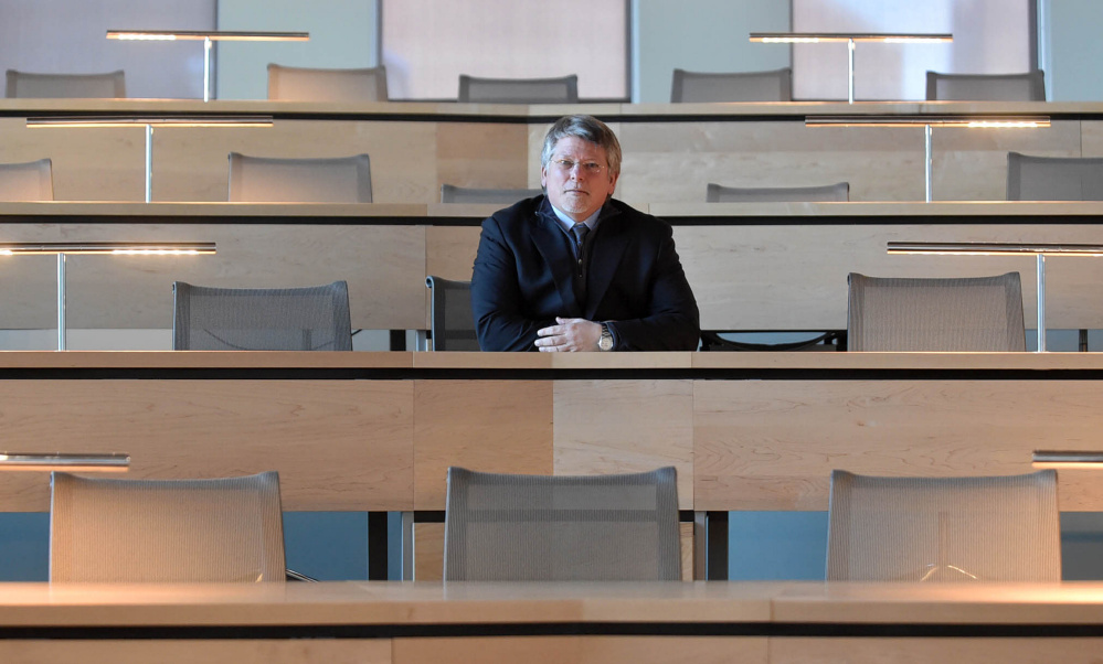 Rick Hopper, president of Kennebec Valley Community College, sits in a new lecture hall at the new Alfond Campus.