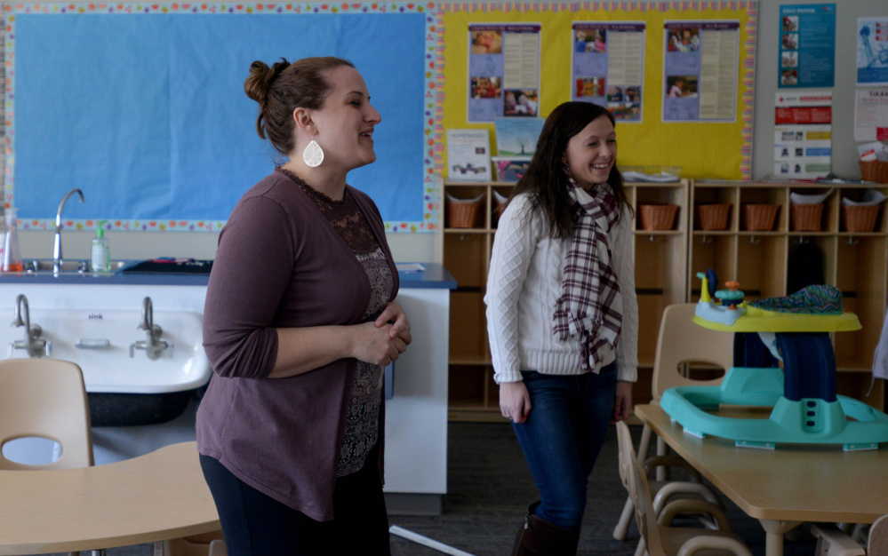 Jessica Powell, project director of the Kennebec Valley Community College Early Childhood Discovery Groups at the new Alfond Campus, discusses aspects of the programs goals. Emma Downing, right, a practicum student teacher, also helps with activities as part of her degree requirements.