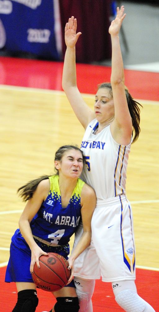 Mt. Abram's Lindsay Huff slams into Boothbay defender Page Brown during a Class C South quarterfinal game Monday at Augusta Civic Center.