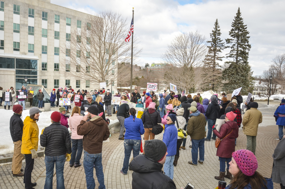 Protesters gather Monday at the State House in Augusta to voice their objections to President Donald Trump. The protest, called Not My President's Day and held on Presidents Day, drew a crowd of participants from across the state.