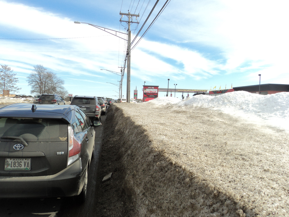 A line of vehicles waits to use the car wash Tuesday at J&S Oil off Kennedy Memorial Drive in Waterville. The photo was taken by a police officer who was patrolling the area and asking people to move.