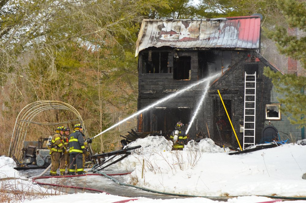 Fire crews from Monmouth and surrounding towns returned to a home on Mt. Pisgah Road around 9 a.m. Wednesday after first extinguishing a fire there earlier in the morning. The fire, which started in a portable garage unit, destroyed the home.