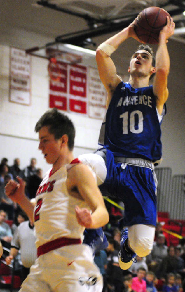 Lawrence senior Mason Cooper, top, shoots over Cony defender Taylor Heath during a Jan. 27 game in Augusta.