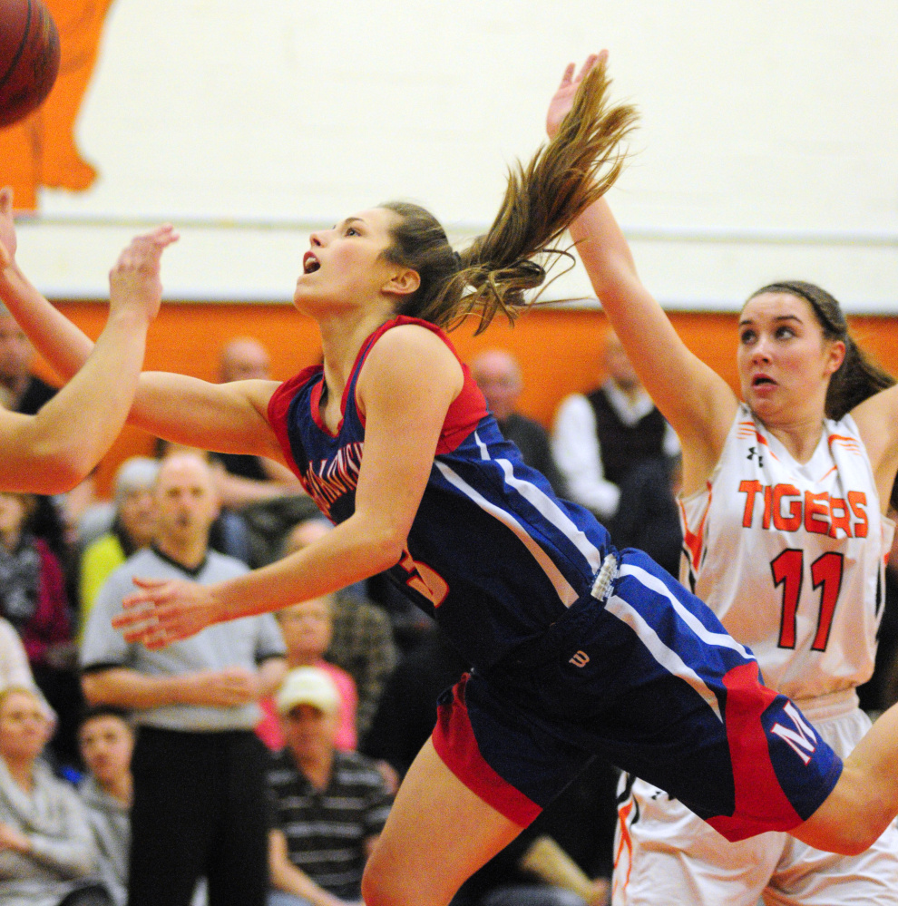 Messalonskee guard Sophie Holmes shoots around Gardiner's Leslie Stevens  during a game earlier this season in Gardiner.