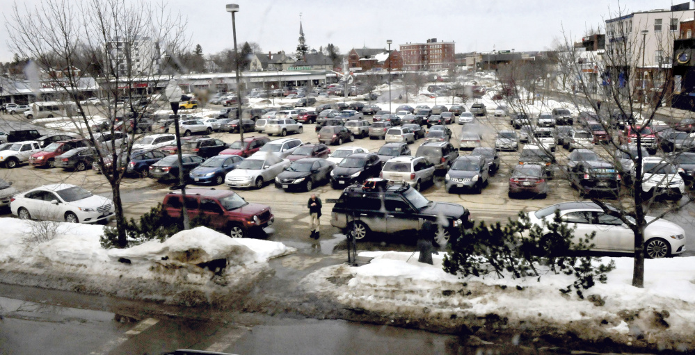 Cars fill up The Concourse parking lot in downtown Waterville on Wednesday, a day after city officials decided to create a new committee to examine parking issues in the downtown area.