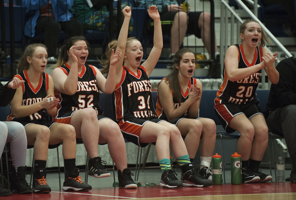 Members of the Forest Hills girls basketball team reacts during a Class D South semifinal against top-seeded Rangeley on Thursday at the Augusta Civic Center. The No. 5 Tigers upset the Lakers.