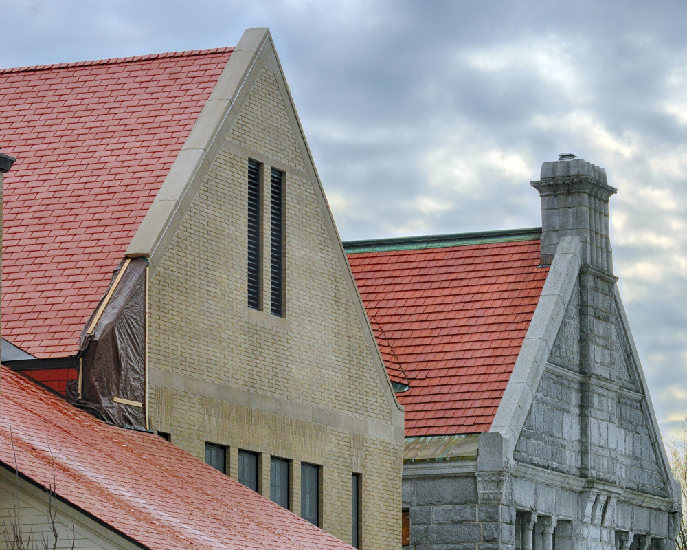 Tarps cover spots where masonry and roof flashing are missing Thusday on the west side of the new addition of Lithgow Public Library in Augusta. The original library building is at right.
