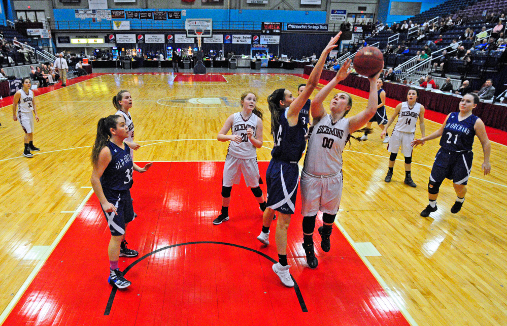 Richmond's Sidney Tilton shoots against Old Orchard during a Class C semifinal game Thursday at the Augusta Civic Center.