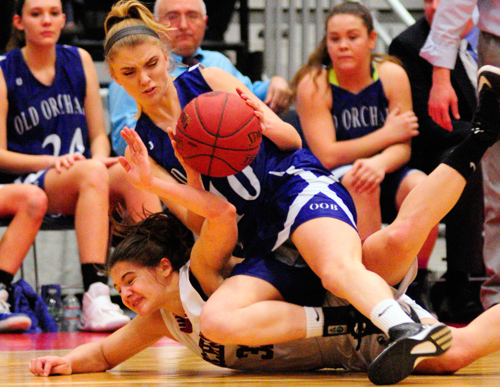 Old Orchard's Victoria Niedzwiecki, top, and Richmond's Mackenzie Abbott scramble for a loose ball during a Class C semifinal game Thursday at the Augusta Civic Center.