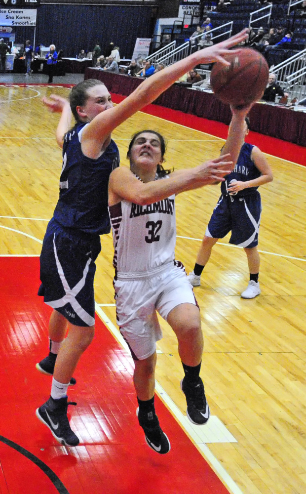 Old Orchard's Maggie Strohm, left, blocks a shot by Richmond's Mackenzie Abbott during a Class C semifinal game Thursday at the Augusta Civic Center.