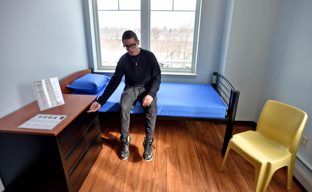 Nicholas Turano, 20, offers a tour of an apartment he hopes to move into at the Mid-Maine Homeless Shelter on Colby Street in Waterville on Friday.