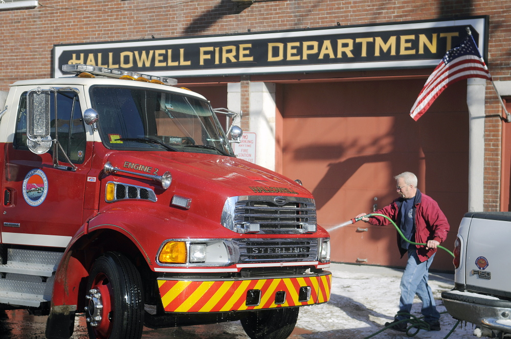 Richard Clark washes a Hallowell fire engine at the city's station on Second Street in this 2015 file photo. City Council voted recently to move fire services to a yet-to-be built station in Farmingdale, but a citizen is challenging the decision.